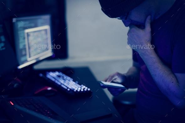 Man sitting using mobile phone - Stock Photo - Images
