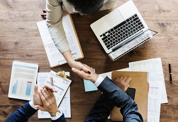 Businesspeople shaking hands together - Stock Photo - Images