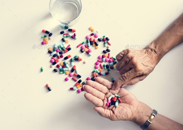 Closeup of hands taking pills health treatment isolated - Stock Photo - Images
