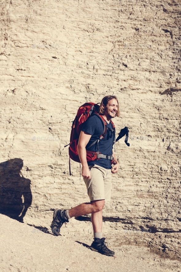 Hipster man traveling with backpack - Stock Photo - Images