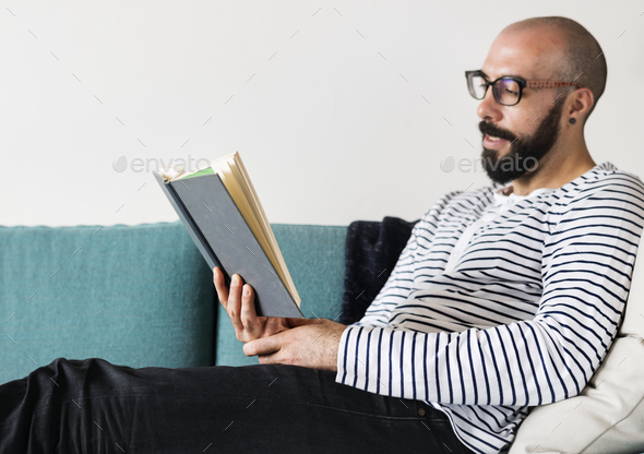 Closeup of man reading a book - Stock Photo - Images