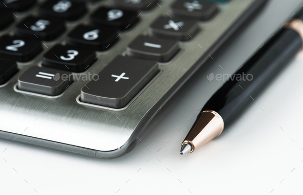CLoseup of calculator with pen - Stock Photo - Images
