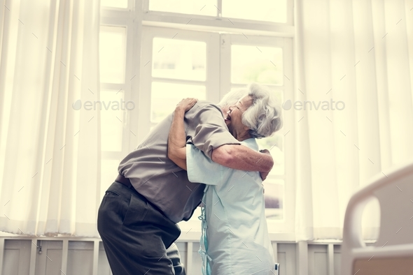 Old couple hugging each other - Stock Photo - Images