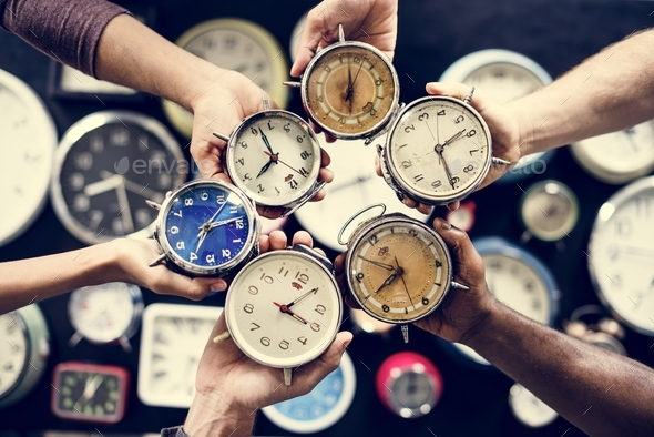Hands holding clocks - Stock Photo - Images