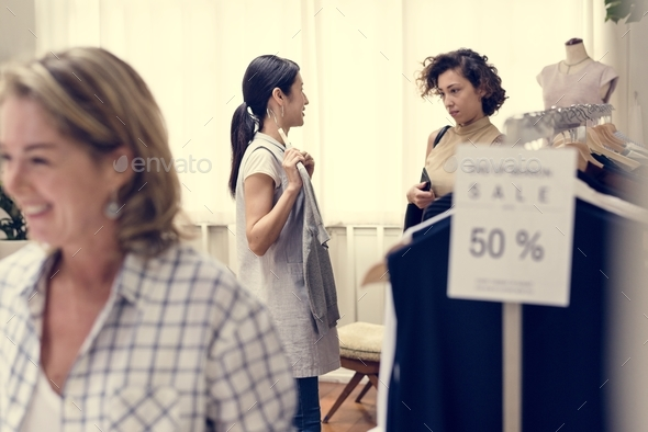 Customers checking out clothing shop - Stock Photo - Images