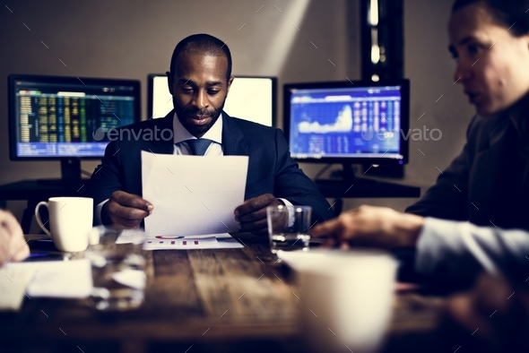 Group of entrepreneur analysing for investment in meeting room - Stock Photo - Images