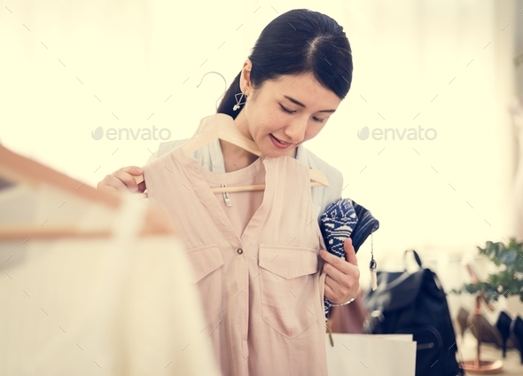 Woman trying out a dress - Stock Photo - Images