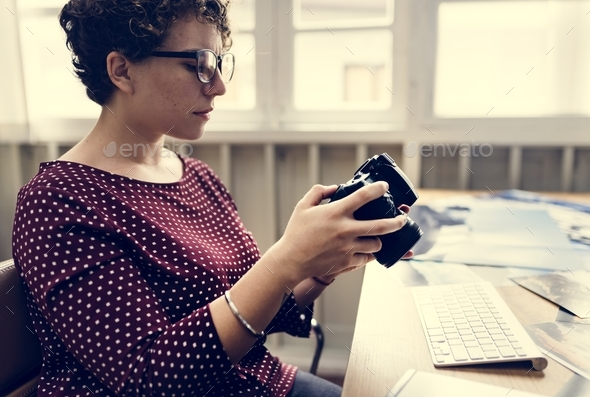 Businesswoman working with camera - Stock Photo - Images