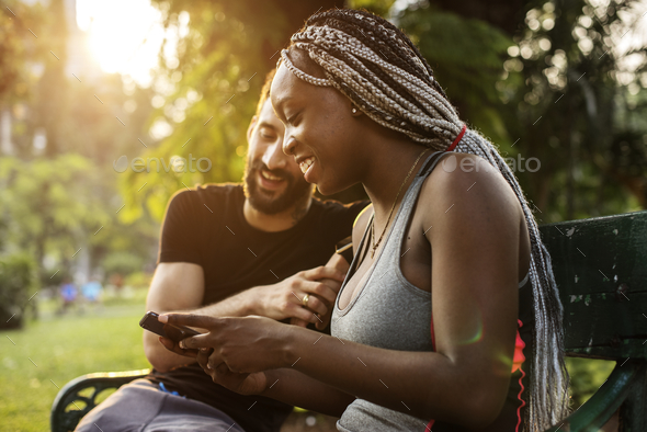 A couple spending time together in the park - Stock Photo - Images