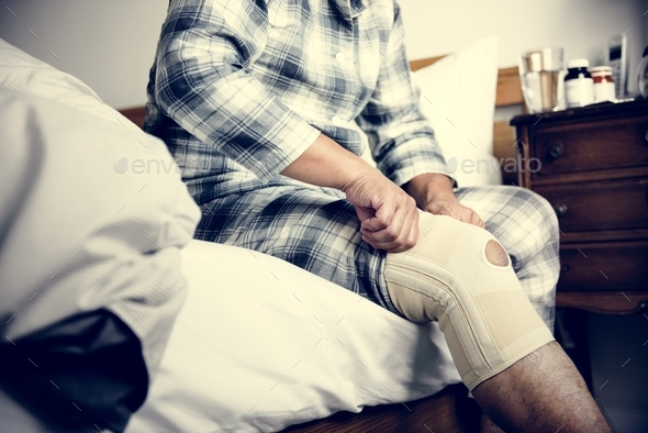 A man having a knee injury - Stock Photo - Images