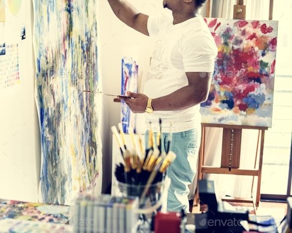 Black artist man doing artwork - Stock Photo - Images