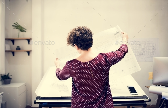 Woman working on document work - Stock Photo - Images