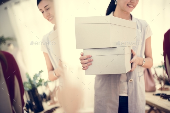 Woman carrying boxes of shoes - Stock Photo - Images