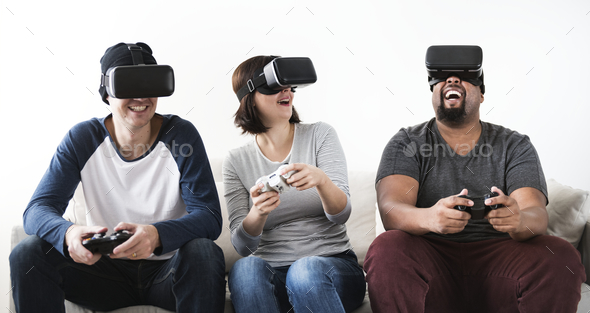 Group of diverse friends enjoying virtual reality game - Stock Photo - Images