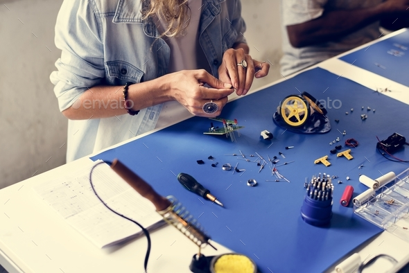 Group of people working at eletronic repair shop - Stock Photo - Images