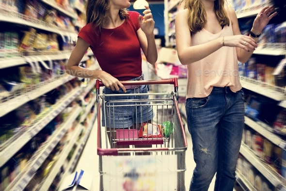 Women choosing food from grocery store supermarket - Stock Photo - Images