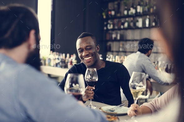 People having meal together in a restaurant - Stock Photo - Images