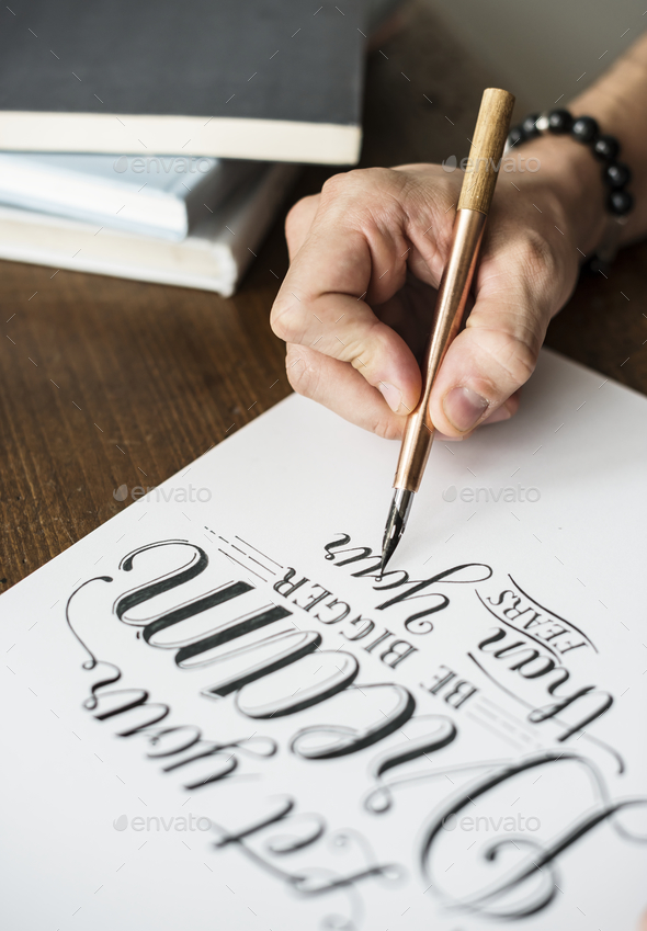 Closeup of a calligrapher working on a project - Stock Photo - Images