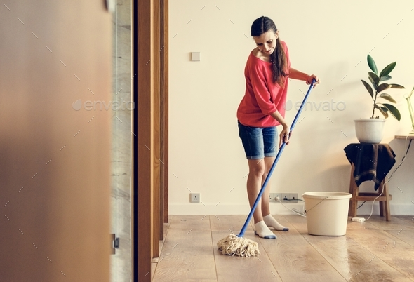 Caucasian woman doing house chores - Stock Photo - Images