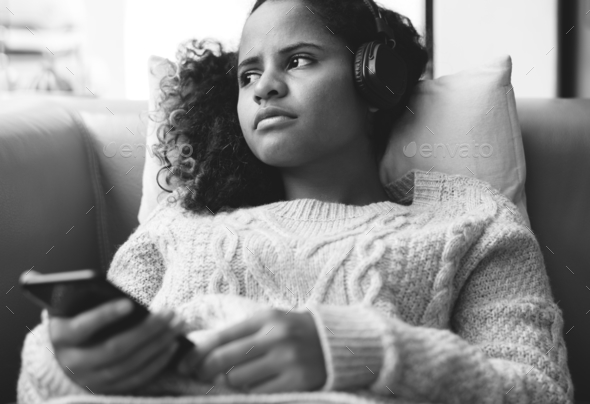 Woman listening to music with headphones on - Stock Photo - Images