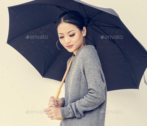 Asian woman holing umbrella on white background - Stock Photo - Images