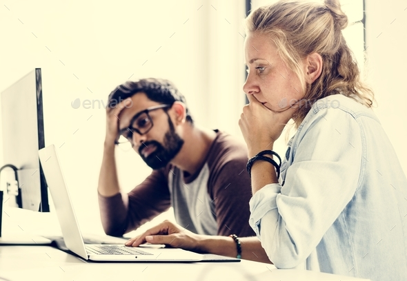 Computer technicians friends with worried face expression - Stock Photo - Images