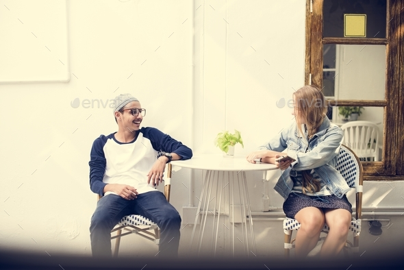 Teenagers talking together - Stock Photo - Images