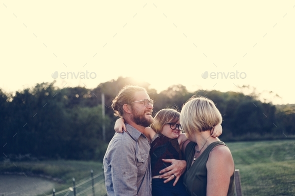 A Caucasian family is spending time at the farm together - Stock Photo - Images