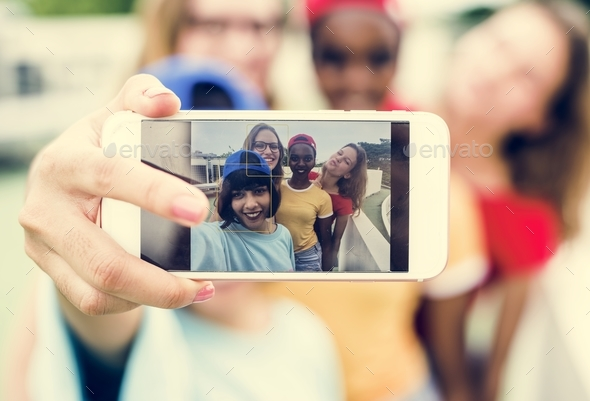 A diverse group of women taking selfie together - Stock Photo - Images