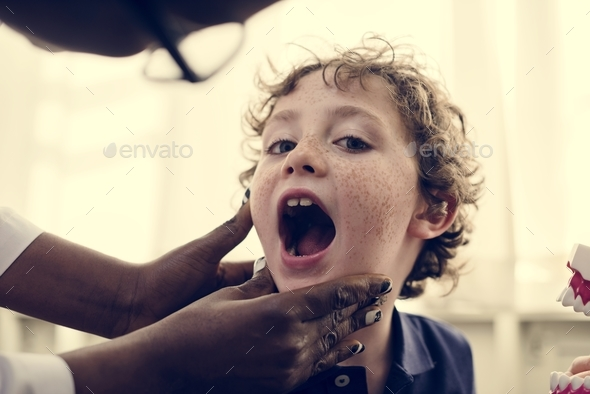 Young boy having his teeth checked - Stock Photo - Images