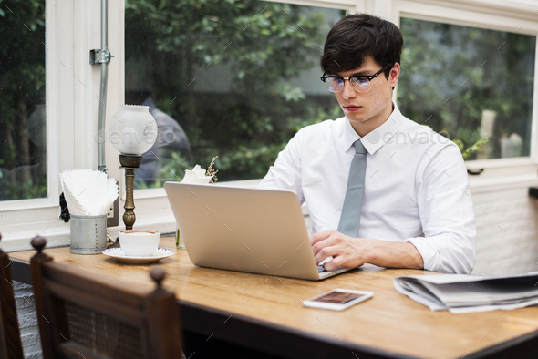 Businessman working on laptop in office - Stock Photo - Images