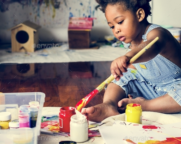 Black kid enjoying color painting - Stock Photo - Images