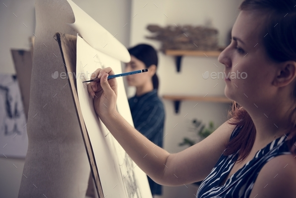 Woman working on painting - Stock Photo - Images