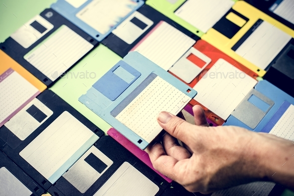 Hand holding floppy disk drive data storage - Stock Photo - Images
