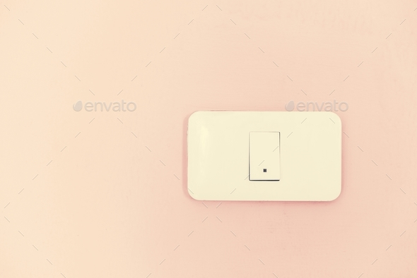 White light switch electric power supply on pink wall - Stock Photo - Images