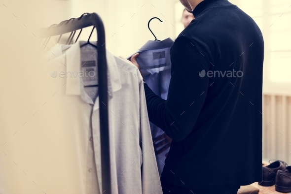 People checking on clothes - Stock Photo - Images
