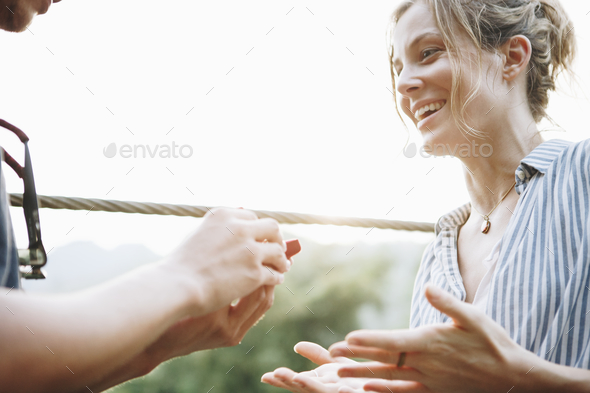 Man proposing to his happy girlfriend outdoors love and marriage concept - Stock Photo - Images