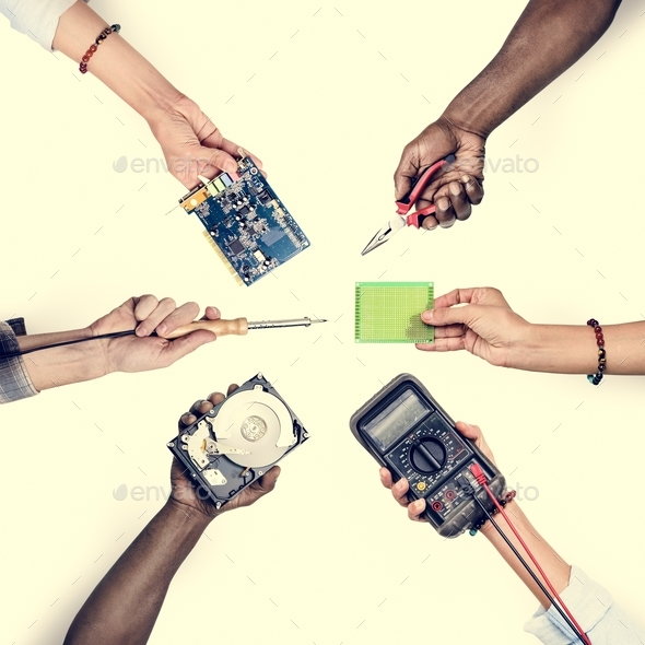 Group of hands holding computer electronics parts isolated on white - Stock Photo - Images