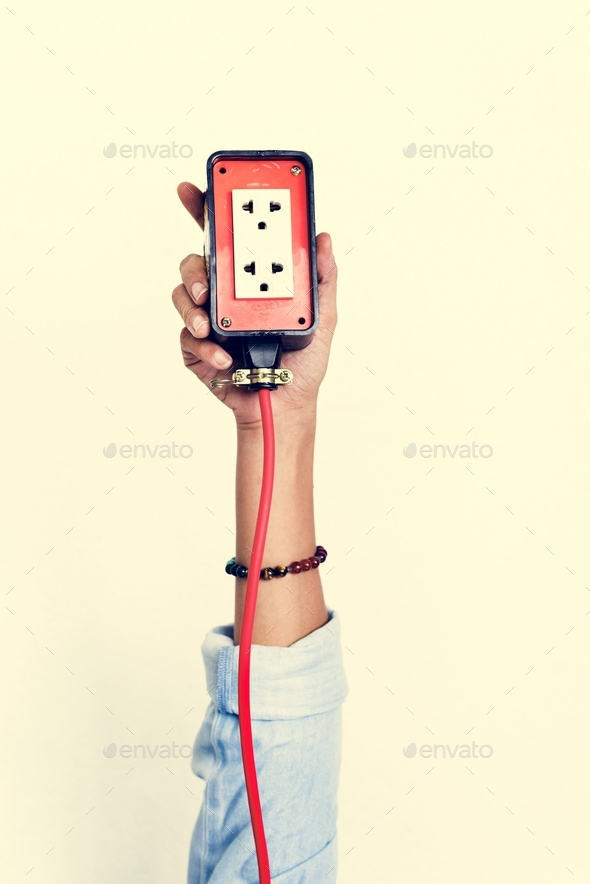 Hand holding electric outlet isolated on background - Stock Photo - Images