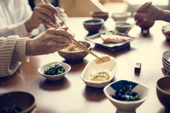 Eating japanese food - Stock Photo - Images