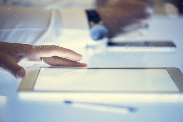 Hand on a tablet on cyber space table screen - Stock Photo - Images