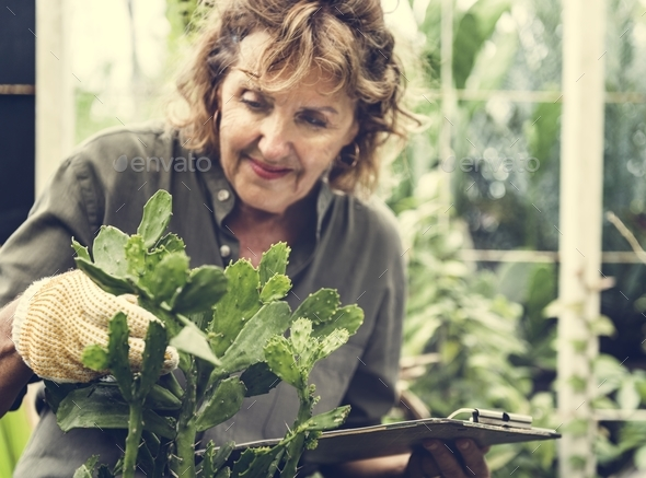 Woman with gardening hobby - Stock Photo - Images