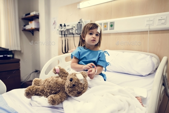 Sick little girl in a hospital - Stock Photo - Images