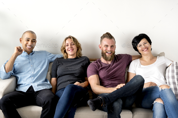Diverse friends sitting together - Stock Photo - Images