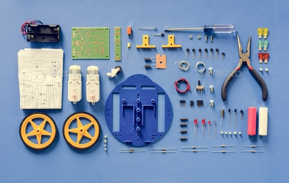 Electronics tools equipments flat lay on blue background - Stock Photo - Images