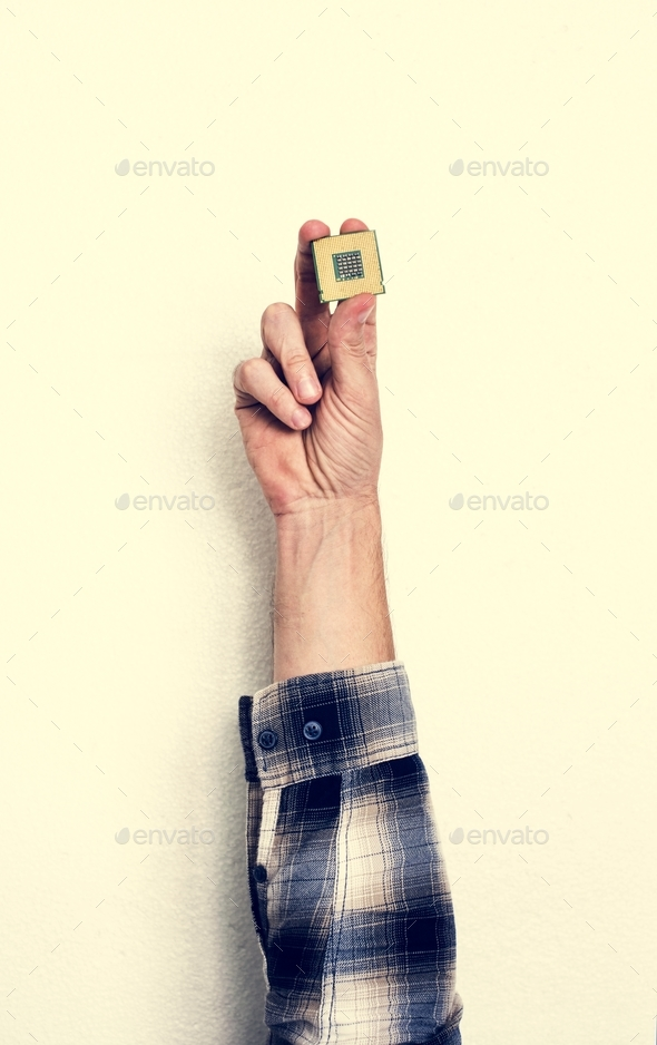 Hand holding computer processor isolated on white background - Stock Photo - Images