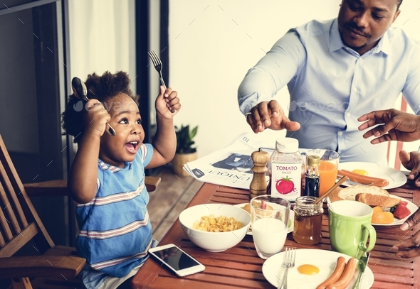 Black family having breakfast together - Stock Photo - Images