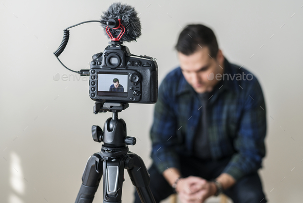 White blogger recording video - Stock Photo - Images