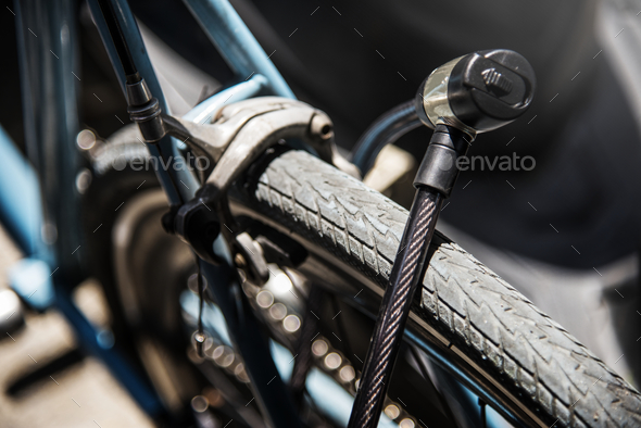 Metal lock on a bicycle wheel - Stock Photo - Images