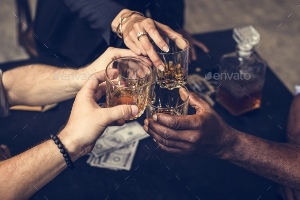 Diverse hands clinking alcohol glasses - Stock Photo - Images
